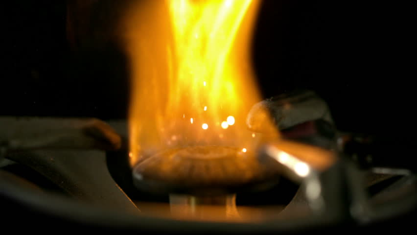 Fire lighting up in the darkness in slow motion