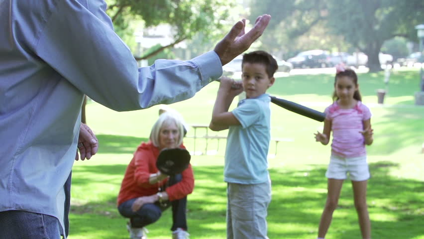 Grandparents Playing Baseball With Grandchildren In Park - HD stock footage clip