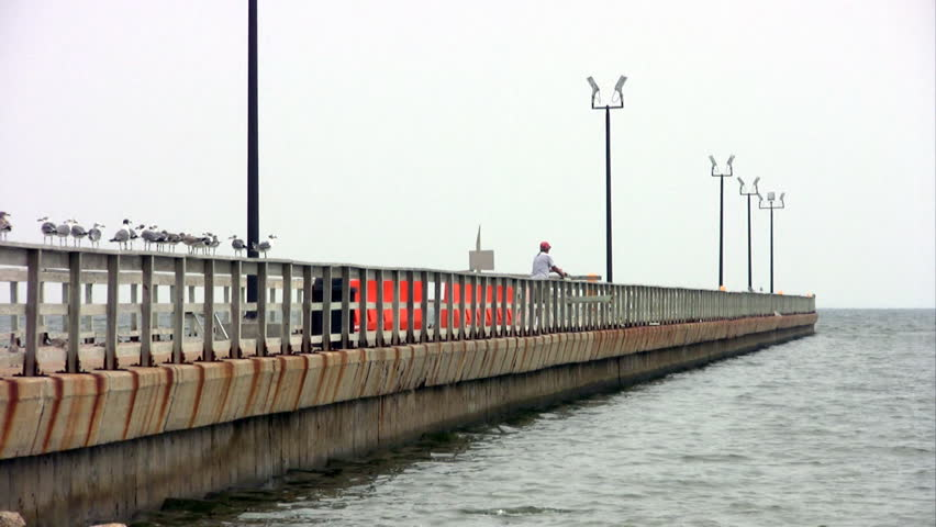 Video Of A Fisherman On A Fishing Pier Extending Into The
