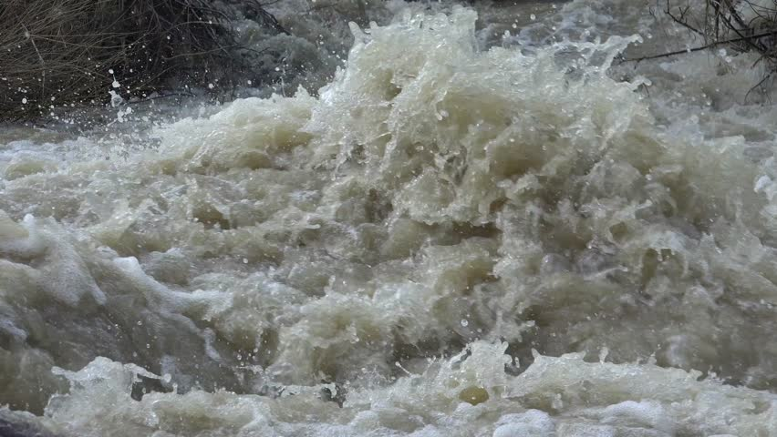 Ultra HD 4K Mountain Muddy River in Flood after Torrential Rain, Flooding by Rain, Storm, Stormy, Flooded Stream, Flowing Water Calamity Close up - 4K stock footage clip