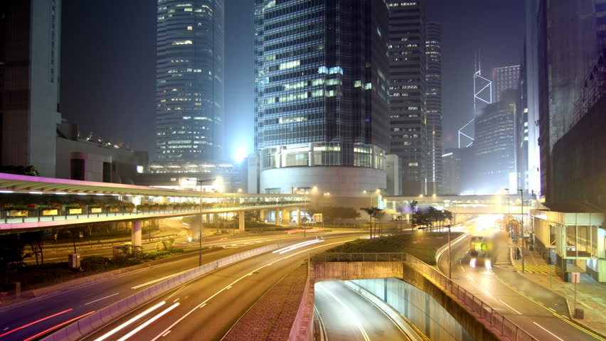Cityscape timelapse at night. Hong Kong. Busy traffic across the main road at rush hour. - HD stock video clip