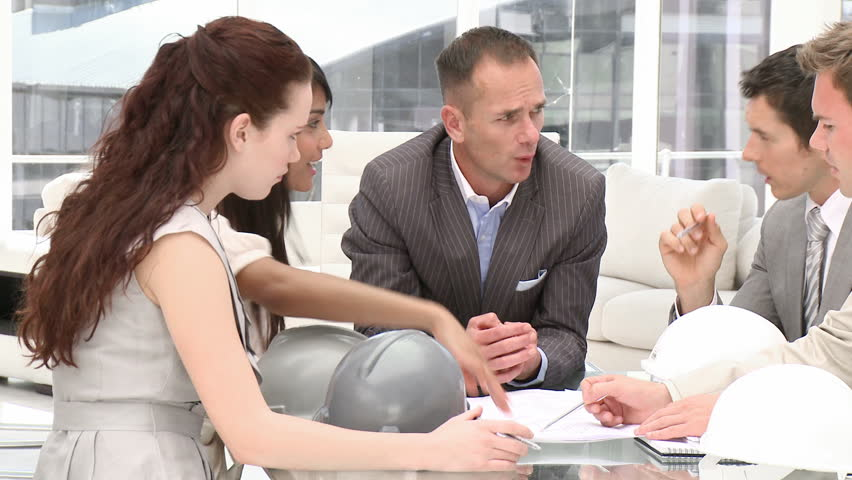 A group of architect studying a construction plan in a meeting - HD stock footage clip