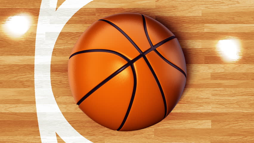 Ball for basketball with realistic texture rotate on background of glossy wooden floor of basketball field. Animation of seamless loop.