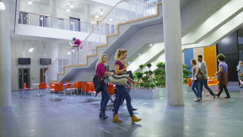 Diverse group of students in large modern university building