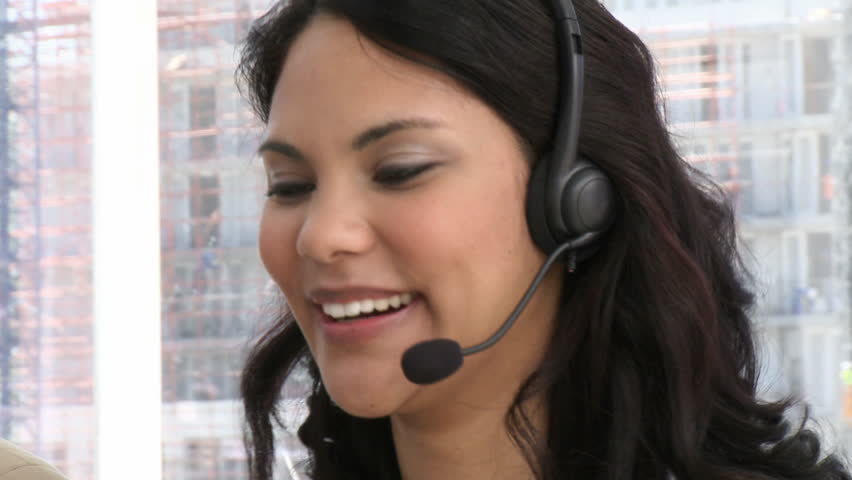 Laughing customer service representative at work - HD stock footage clip