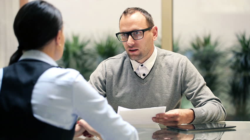 Businesswoman talking with businessman during job interview