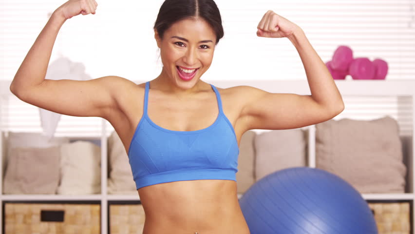 Strong Chinese woman showing off muscles
