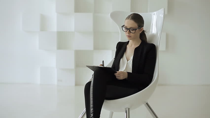 Pretty Businesswoman Using Smart Glasses In Her Office
