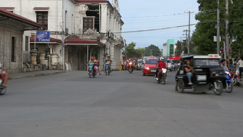 TAGBILARAN CITY, PHILIPPINES - JUN 15: Afternoon rush hour traffic and an abundance of motorcycle taxis on June 15, 2014 in Tagbilaran City, Philippines