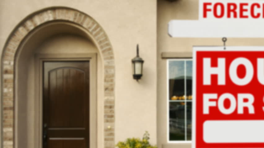Panning Foreclosure Home For Sale Sign and House.