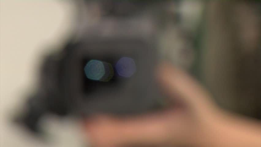 Cameraman adjusting the focus manual | Shutterstock HD Video #667408