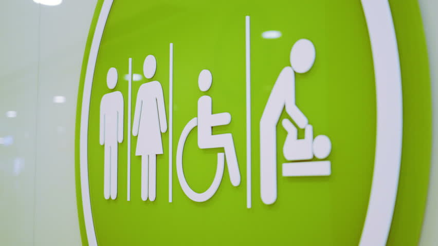 Restroom and Toilet Access Sign. Sign of toilet or restroom access for baby caring parents, disable people, male and female. 4K tile up shot.