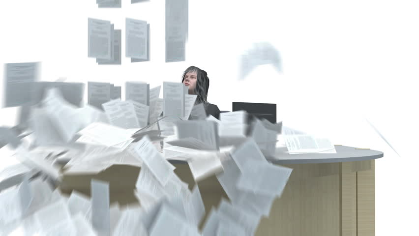 Business woman sitting at desk and deluged with paperwork in intray