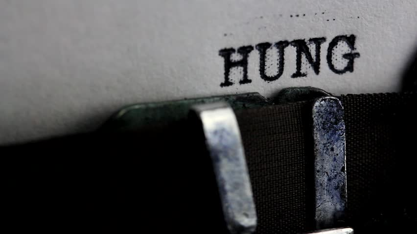 Typing word 'HUNGER' on typewriter