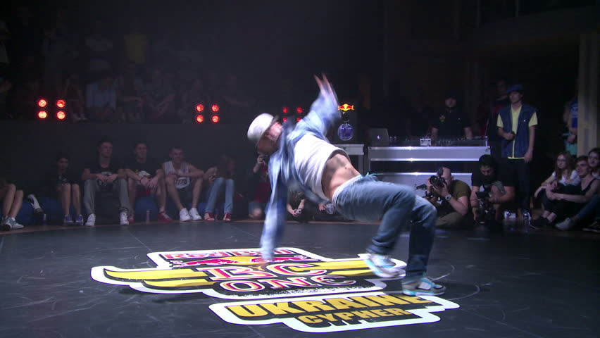 KIEV, UKRAINE - JUNE 28, 2014: Bboys battle on the dance floor in a nightclub, hip-hop, break dance. Break dance competitions in Kiev Red Bull BC One Cypher.