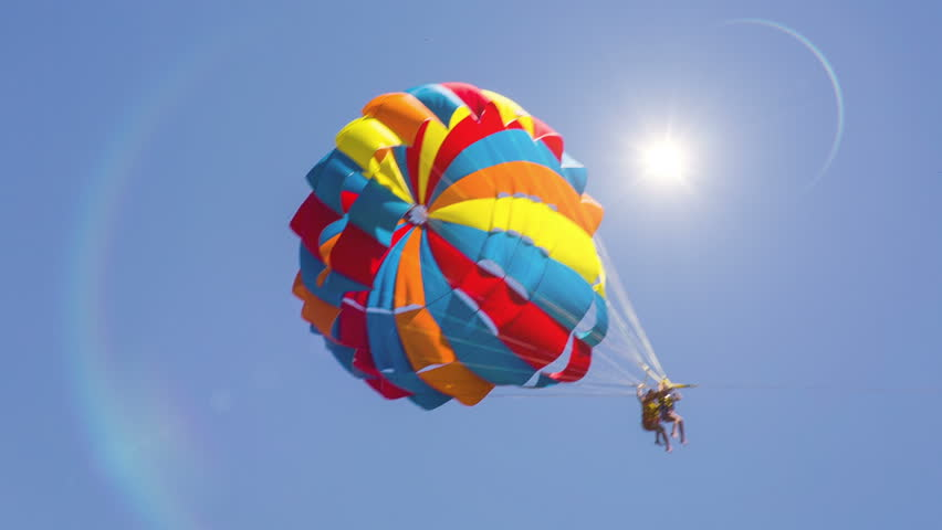 Parachute moving across the screen. Bright Sun. HD 1080. - HD stock video clip