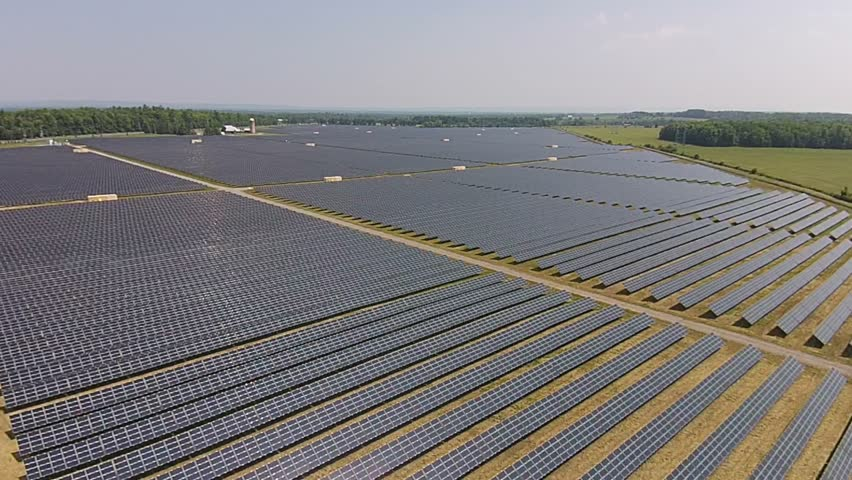 ONTARIO, CANADA : The Provincial Government of Ontario Has Introduced A Clean Energy Plan Which Has Created Investments By Business In Renewable Energy Like These Solar Panel Farms.