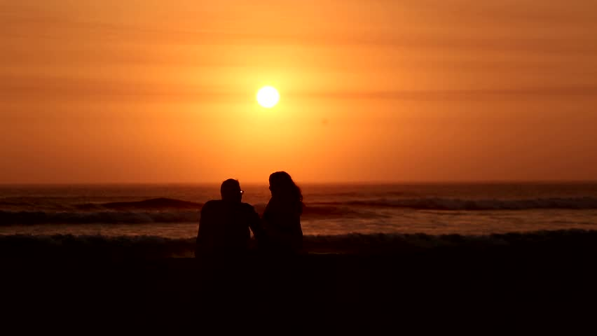 video footage of a couple in the sunset at a beach - HD stock video clip