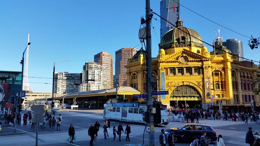 Melbourne City Victoria Australia - Flinders Street station Establishing shot of Melbourne City Victoria Australia. know for it's architecture, Yarra river the amazing looking Flinders Street station