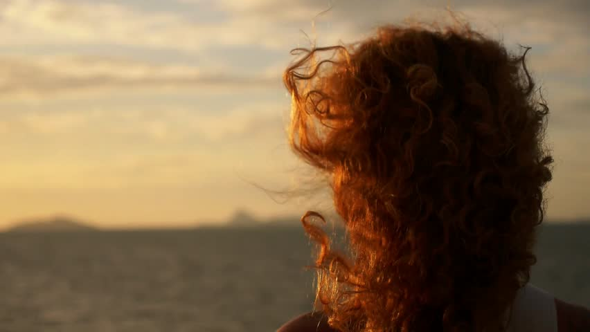 Young Woman with Curly Hair and Tattoo Standing against Impressive Spectacular Sunset on the Yacht. Slow Motion.