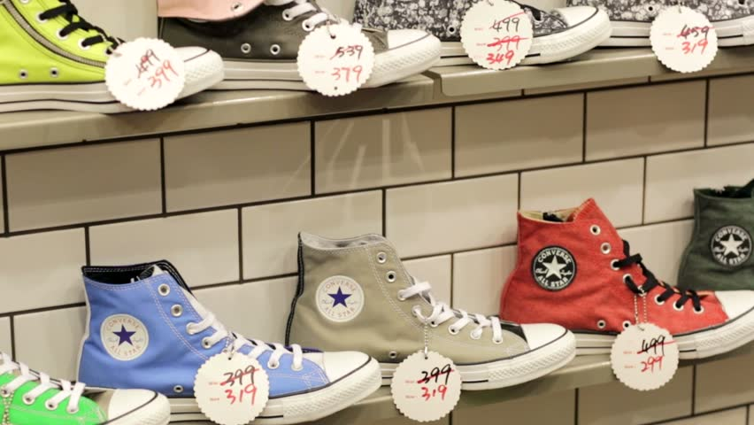 MACAU, CHINA - CIRCA JUNE 2014: Sneakers in the Converse store. Converse is an American company with a production output that primarily consists of shoes, lifestyle fashion, and athletic apparel.