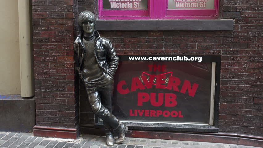 LIVERPOOL, MERSEYSIDE/UK - JUNE 30, 2014: John Lennon statue, The Beatles in Mathew Street. Mathew Street is known worldwide as the location of the Cavern Club where the Beatles played.