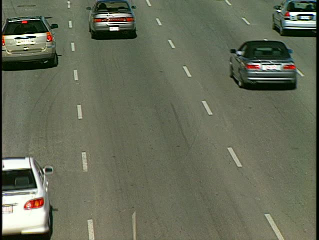 looking down on traffic going away (BetacamSP) - SD stock footage clip