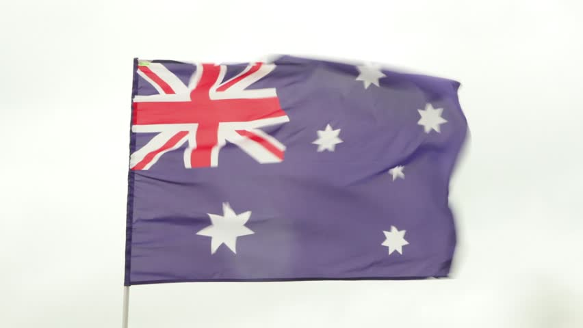 Australian flag waving on the wind in rainy day - HD stock footage clip