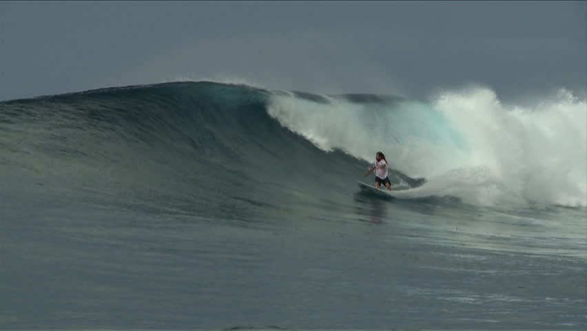 Indonesia, 2012. A man carves up some waves on his surfboard, long shot | Shutterstock HD Video #6818152