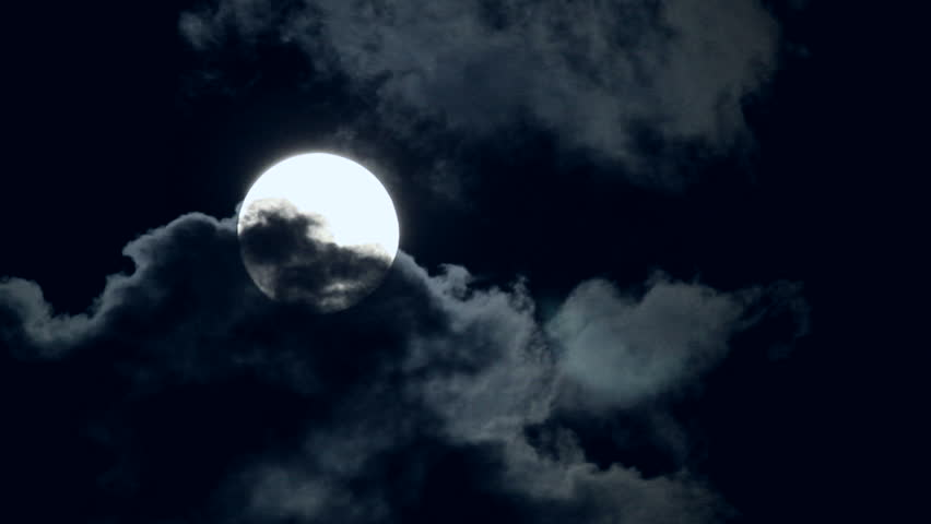 Eerie Full Moon Drifting Amid Dark Clouds. | Shutterstock HD Video #6842317