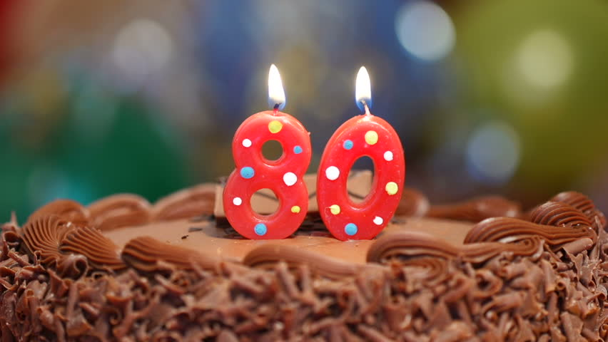 Candles On A Cake Are Blown Out For A 10th Birthday Ten
