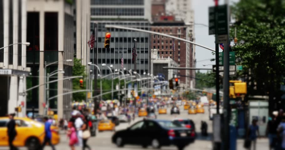 NEW YORK CITY - Circa, July, 2014 - An defocused shot of pedestrians and traffic crossing 6th Avenue in Manhattan. | Shutterstock HD Video #6866347