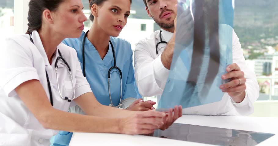 Medical team looking at x-ray together at the hospital | Shutterstock HD Video #6867976