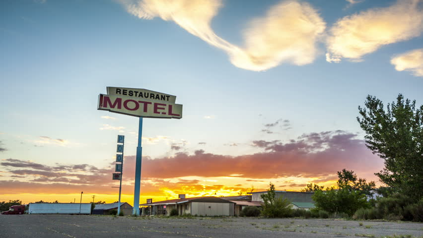 Beautiful sunset with motel sign in front. - HD stock video clip