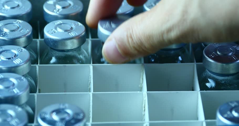 4k Add injection bottle from box.medical health hospital equipment & drug vial. gh2_08236_4k | Shutterstock HD Video #6923119
