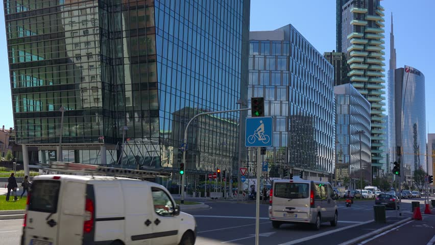 MILAN, ITALY - MAY 26, 2014: Traffic on on viale della Liberazione. This street is business center of Milan and showcase of modern architecture. - 4K stock video clip
