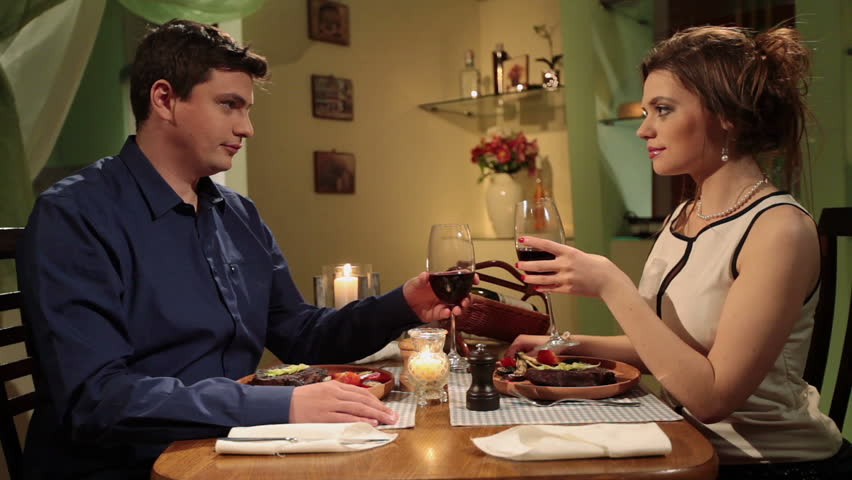 Romantic date, young attractive couple having candlelight dinner - HD stock video clip