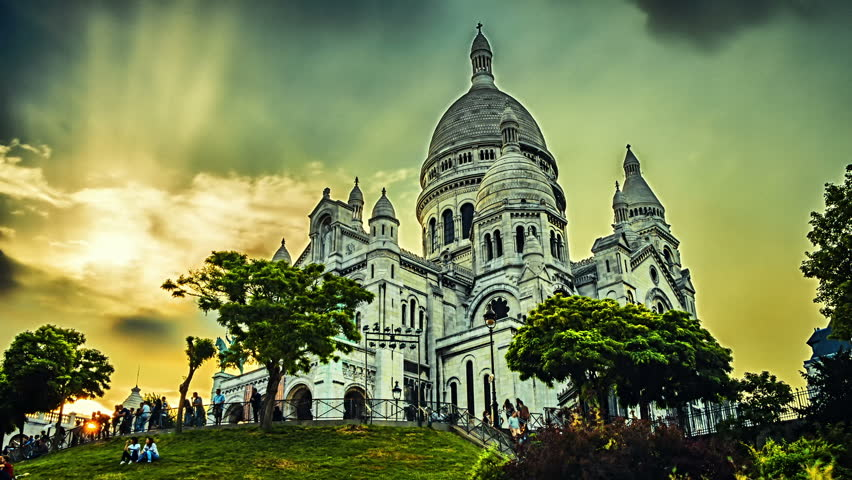 Sunset over Sacre Coeur Cathedral, Montmartre. Paris, France. Full HD, 1080p | Shutterstock HD Video #6976237