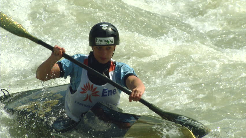 VALTELLINA, ITALY - 11 JUNE 2014: A woman participates in the ICF Wildwater Canoeing World Championships, 11 June 2014 on River Adda in Valtellina (Italy)