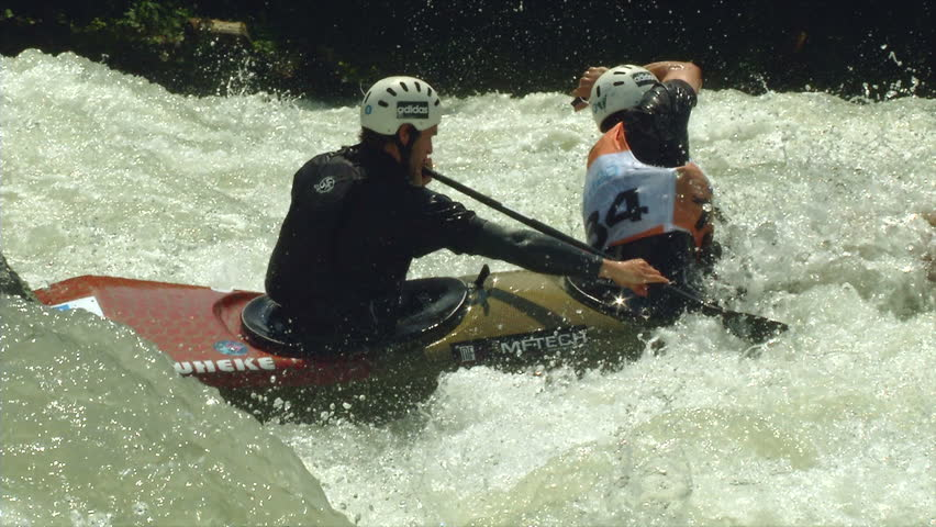 VALTELLINA, ITALY - 11 JUNE 2014: Two athletes participates in the ICF Wildwater Canoeing World Championships, 11 June 2014 on River Adda in Valtellina (Italy)