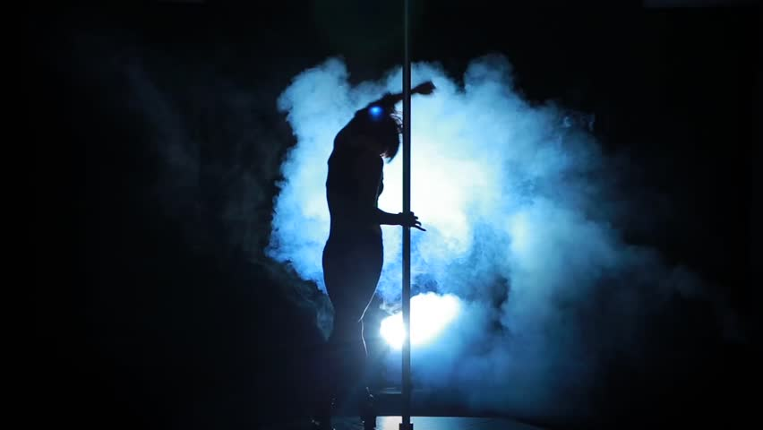 Silhouette Of A Sexy Female Pole Dancing On Blue ...