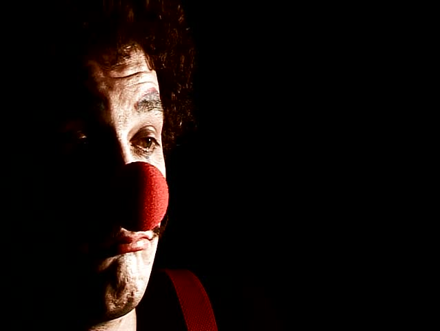 portrait of sad displeasure make up clown