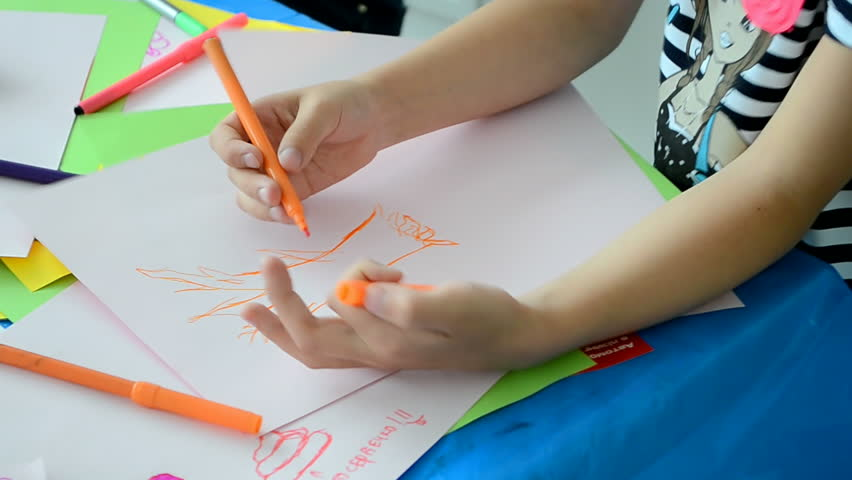 KIEV-MAY 31,2014: girl drawing during NIKO Junior Fest 2014 devoted to International Children's day. Event organized by VAB leasing, NIKO-Ukraine (official dealer of Mitsubishi Motors in Kiev region).