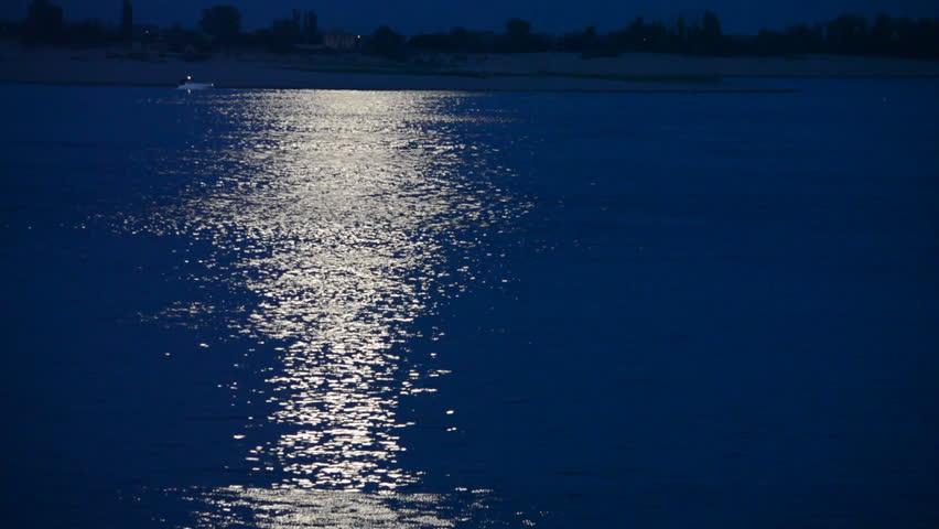 Beautiful lunar path reflection on a dark blue water background   Shutterstock HD Video #7050811