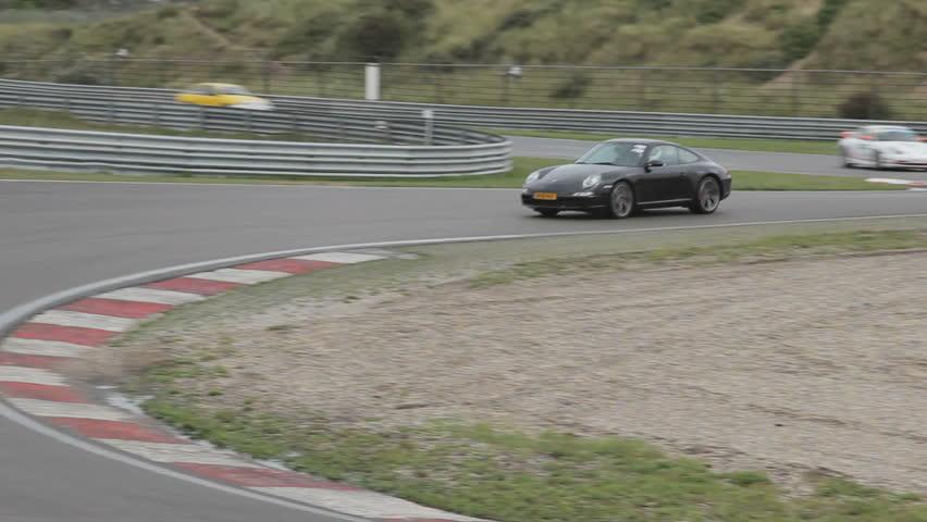 ZANDVOORT, NETHERLANDS - Aug 10: Super Car Sunday - Porsche on track - HD stock footage clip