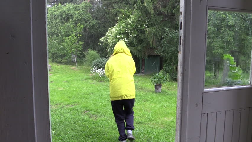 Shower of hail rain fall in rural homestead yard and woman run to outdoor toilet wc. Static shot on Canon XA25. Full HD 1080p. Progressive scan 25fps. Tripod.