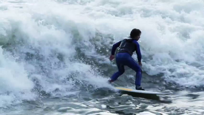 A surfer carves while river surfing in rapids | Shutterstock HD Video #7095118