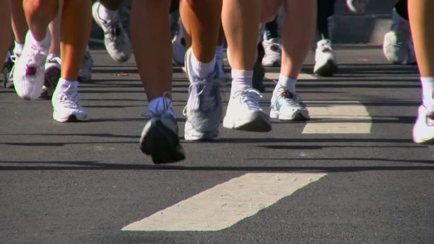 Legs of runners on the city street - HD stock footage clip