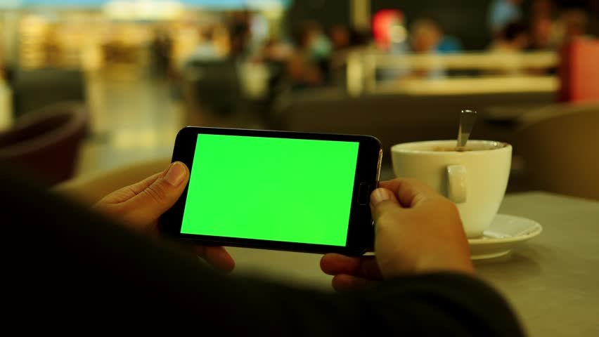 female using tablet phone in cafeteria - green screen - chroma key - isolated mask - display monitor - watching looking view - person people lifestyle
