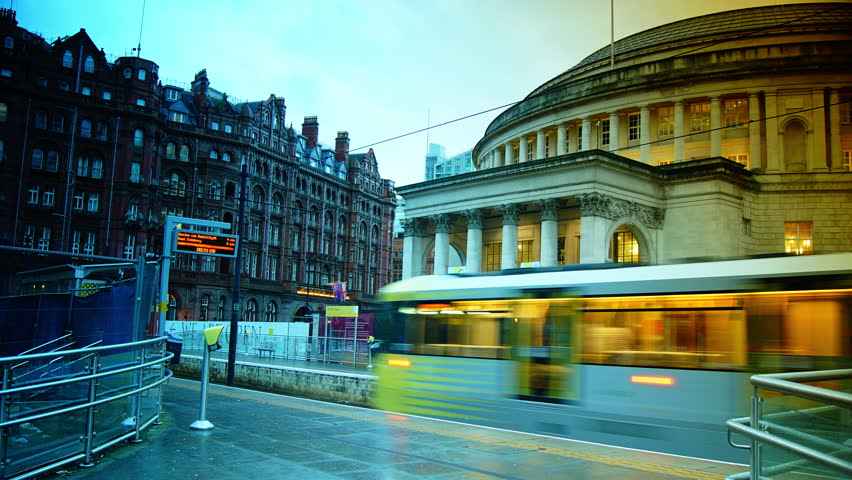 MANCHESTER, UNITED KINGDOM - CIRCA 2014: Manchester Metrolink trams departs St Peter's Square station in front of the Central Library.